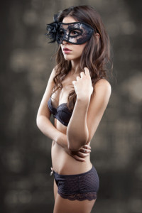 Woman in lingerie wearing a mask