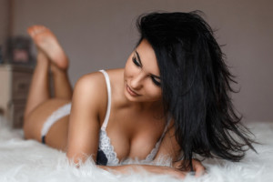 Young beautiful woman in sexy lingerie lying on the bed