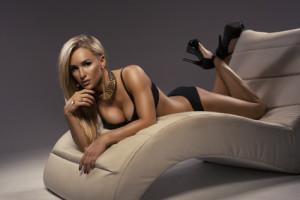 Sexy blonde woman sitting on a stylish leisure