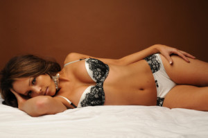 Sexy young woman on bed
