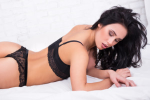 young beautiful woman in lace lingerie lying on bed