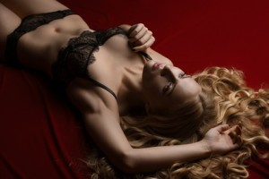 Sexy blonde in luxurious lace underwear in studio