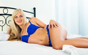Sexual smiling blonde posing in lingerie