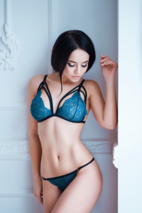 Perfect, sexy body, belly and breast of young woman wearing seductive lingerie. Beautiful hot female in underwear posing on sensual way